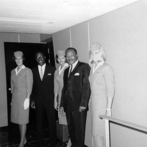 Dr. Martin Luther King, Jr. flies Delta, 1965. Shown in jetway at New York-JFK.