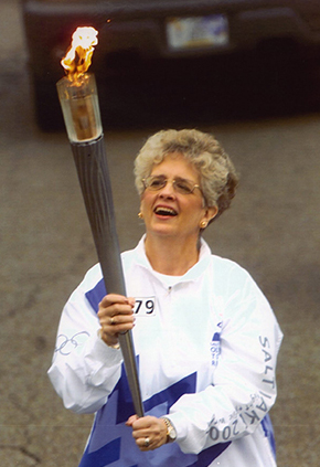 Judy carrying 2002 Olympic torch