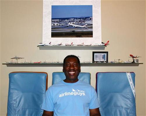 Sly Pittman in his airplane room at home