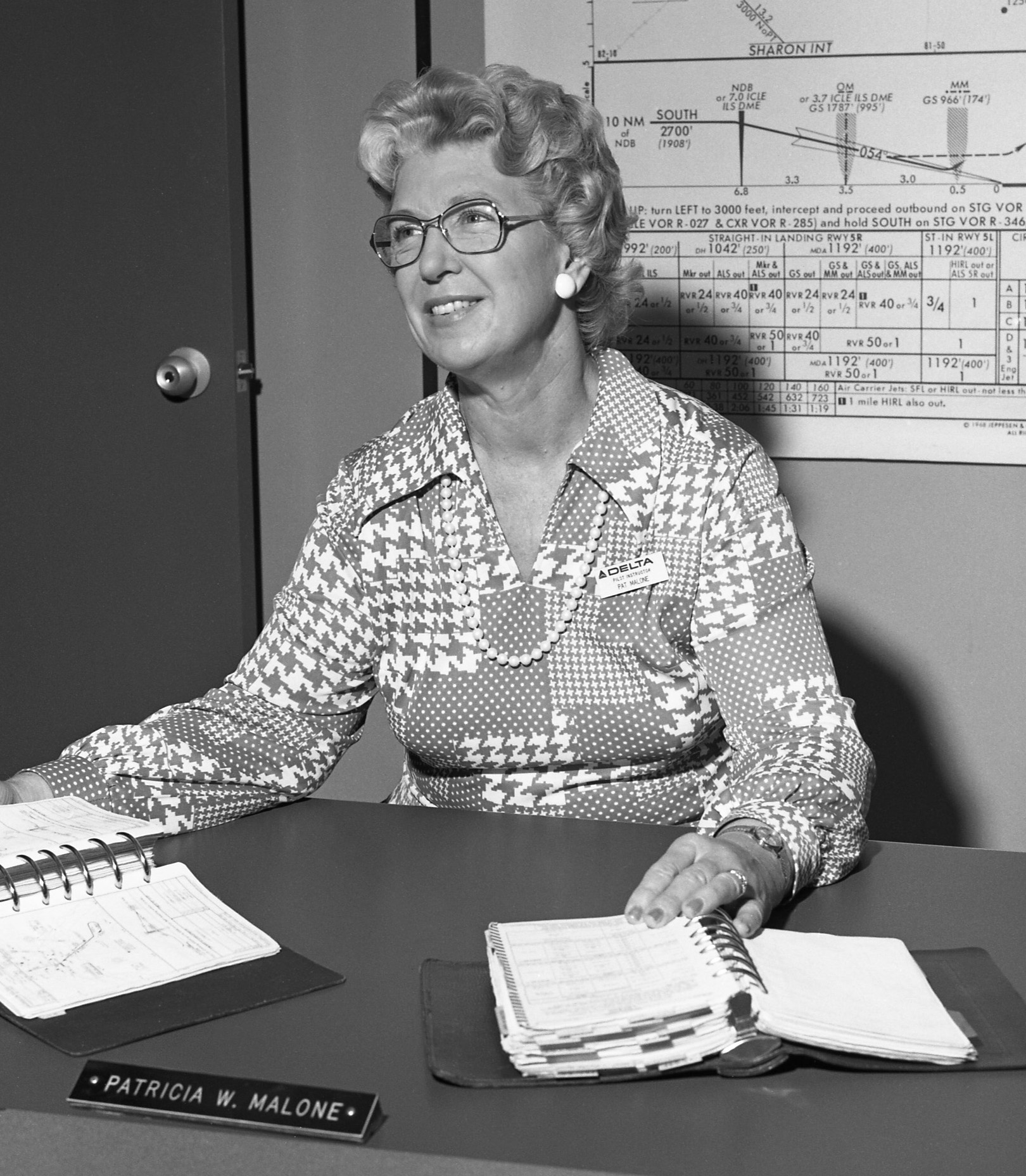 dl_training_instructor_pat_malone_1975_at_desk