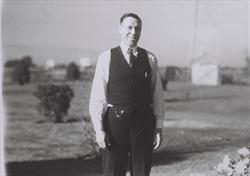 dl_ceo_woolman_standing_with_field_behind_late1920s-1930s