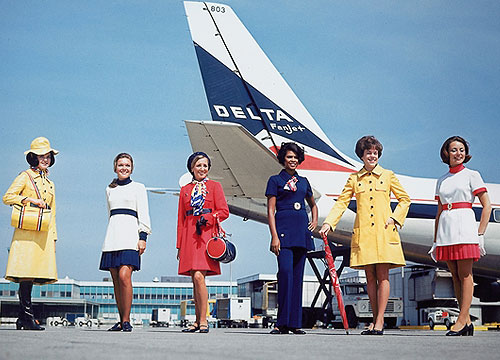 3feca37722a First Delta flight attendant uniform with pants—navy blue bell bottoms—and  hats no longer required. Pleated mini-skirts and tunics of wrinkle-free  polyester ...