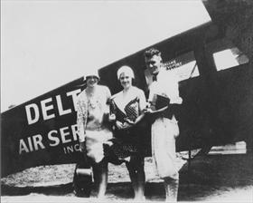 Travel Air with passengers, ca. 1929-1930